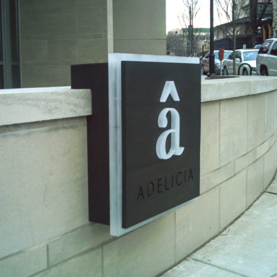 Exterior signage with cut letters